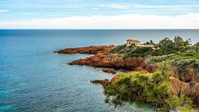 Stone house red rocks coast Cote d Azur near Cannes, France royalty free stock photo