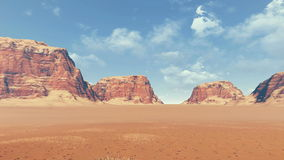 Red rocks among desert land panoramic view. Panorama of rock formations among barren lands during daytime. Сamera makes a smooth horizontal (panoramic) motion stock video
