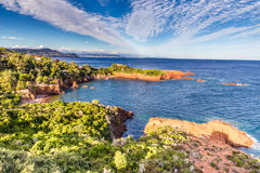 Red rocks of Esterel Massif-French Riviera,France. Esterel Massif And Red Rocks Covered by Trees During Summer Day-French Riviera, Provence-Alpes, Cote d'Azur Royalty Free Stock Image