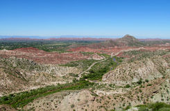 Red rocks and green valley mountain landscape Royalty Free Stock Photos