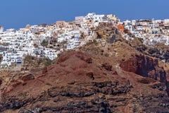 Red rocks and Oia town, Santorini island, Greece Stock Photography