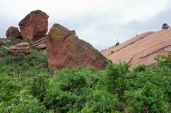 Red Rocks Outcrops and Vegetation. Red rocks park outcrops and rocky terrain surrounded by lush vegetation in jefferson county colorado Royalty Free Stock Photo