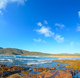 Red rocks by Porto Ferro shore Royalty Free Stock Photo