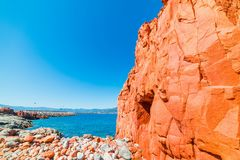 Red rocks in Rocce Rosse beach. Sardinia, Italy Royalty Free Stock Photo