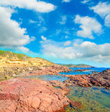 Red rocks by the sea in Sardinia Stock Images