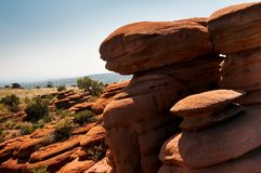 Red rocks in the South African Magaliesberg plateau. A group of fantastically nature shaped yellow red rocks in the South African Magaliesberg plateau on a sunny Stock Photos