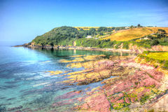 Red rocks at Talland Bay Cornwall England UK Stock Photo