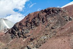 Red rocks in Tien Shan mountains Stock Images