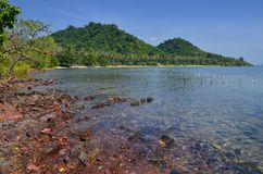 Red rocks and translucid sea at Cambodian island Royalty Free Stock Image