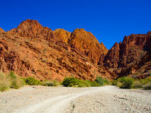 Red rocks of Tupiza. Red rock formations in the dry valley - quebrada - of western-like landscape near small town Tupiza in southern Bolivia Stock Photography
