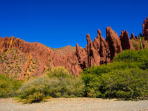 Red rocks of Tupiza. Red rock formations in the dry valley - quebrada - of western-like landscape near small town Tupiza in southern Bolivia Royalty Free Stock Photos