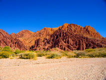 Red rocks of Tupiza. Red rock formations in the dry valley - quebrada - of western-like landscape near small town Tupiza in southern Bolivia Stock Photos