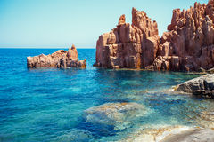 Red rocks and turquoise water of Arbatax, Sardinia. Italy Stock Photography