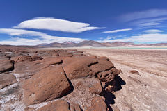 Red rocks under blue sky. Red rocks and mountains under blue sky Royalty Free Stock Photography