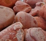 Red rocks. Rocks used for decorating gardens and similar Stock Photos