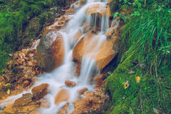 Red rocks waterfall in Latvia. 2015 royalty free stock photos