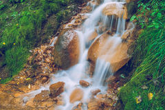 Red rocks waterfall in Latvia. 2015 royalty free stock photography