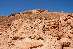 Red Rocky Hill In The Desert Landscape Royalty Free Stock Image