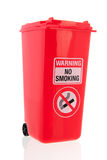 Red roll container for cigarettes Stock Images