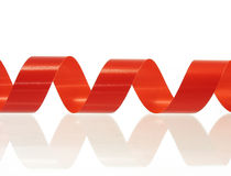 Red rolled ribbon Stock Images