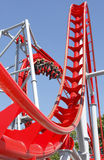 Red roller coaster. Ride at fairground theme park stock photo