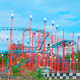 Red roller coaster under a blue sky Stock Photography