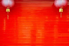 Red rolling door. Of Chinese house with two chinese lanterns in chinatown stock images