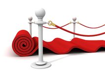 Red Rolling Velvet Carpet with Rubber Stanchions Stock Photo