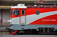 Red Romanian railways electric locomotive parked at Bucharest train station Stock Photography