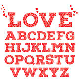 Red romantic alphabet with love inscription made of small red heart shapes  on white background. Sweet love mosaic font. Valentine's day, wedding, love concept Royalty Free Stock Images