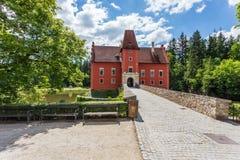 Red romantic castle Cervena Lhota Stock Photos