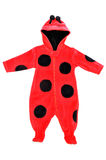 Red rompers with a pattern ladybird. Royalty Free Stock Images