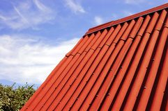 Red roof. Top and blue sky royalty free stock photography