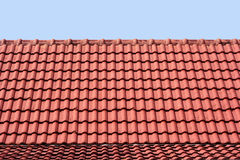 Red roof. Patterned red roof light blue, blue sky stock image