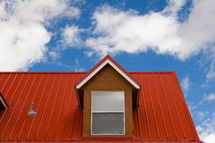 Red roof. Under the sky Stock Image