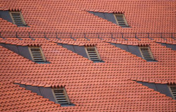 Red roof. And windows on it make a beautiful composition, shot at downtown Munich, Germany Stock Photography