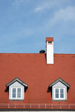 Red roof. With two windows Stock Photos