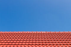 Red roof against blue sky Royalty Free Stock Image