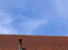 Red roof and blue sky Stock Photo