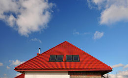 Red roof on blue sky background. Red tiled roof on blue sky background Stock Photos