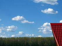 Red roof blue sky Stock Image