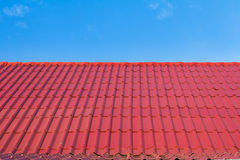 Red roof and blue sky Stock Photos
