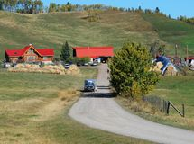 Red roof building on the farm. Red roof building on a Canadian farm beside highway Royalty Free Stock Photo