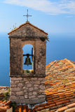 Red roof chapel cross with Mediterranean sea view at the French Royalty Free Stock Images