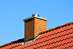 Red roof with chimney Royalty Free Stock Images
