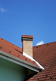 Red roof with chimney. Red house roof with chimney Royalty Free Stock Photography