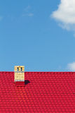 Red roof with chimney Stock Images