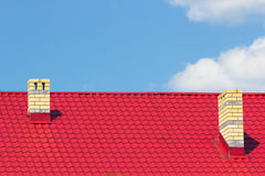 Red roof with chimneys Royalty Free Stock Images
