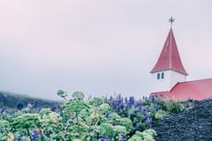 Red roof church in the South of Iceland in Vik in Myrdal royalty free stock photos