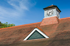 Red roof with a clock Royalty Free Stock Images
